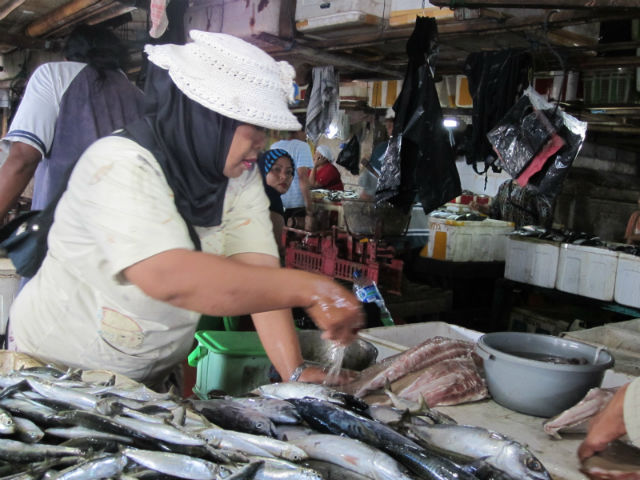 Woman at the fish Market Jimbaran, Bali, Indonesia