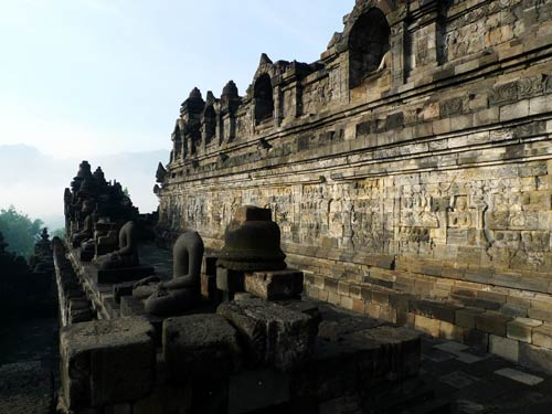 Statues and relief panels at Borobudur Temple