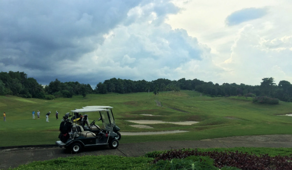 Golfers at the Bintan Lagoon Resort, Indonesia