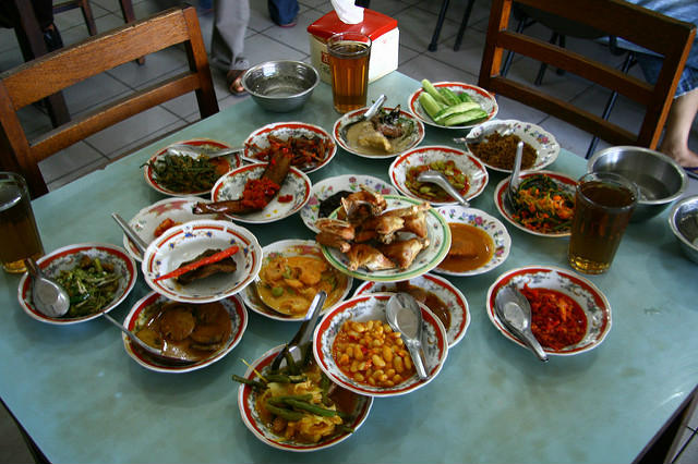 A table spread of Nasi Padang dishes, Bali, Indonesia