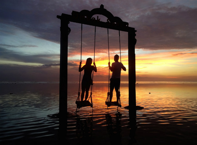 The swing at Gili Islands at Ombak Sunset, Indonesia